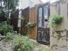 This is a privacy fence. They used old doors that they had taken out of some of their rental properties.