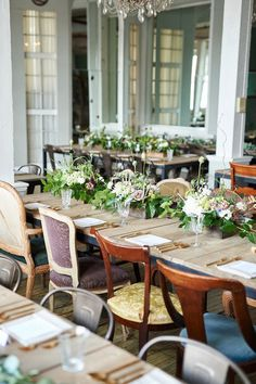 Mix and match chairs at an intimate vintage wedding.