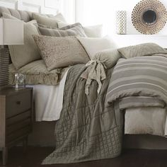 This product is made of a linen cotton blend fabric.It showcasessimple gray and natural stripes, with straight flange for a classic look.