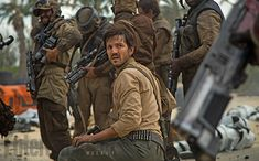 Here we see Diego Luna's Capt. Cassian Andor in the beach battle alongside some fellow Rebel soldiers — all of them human. From the original trilogy, we know a great many creatures also joined the Rebellion. Did those species line up and follow the lead of the humans after the events of Rogue One? Or have we just not seen some of the aliens who will join this battle? Director Gareth Edwards says there are at least two background creatures who fight with the squad, but they aren't major…