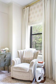neutral drapes roman shade bedroom