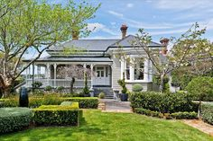 Love the box hedge. Corner profile of house similar to ours.
