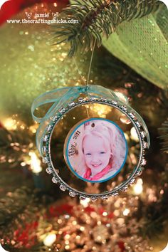 DIY photo ornament made with bangle bracelets, wood, fishing wire, ribbon and modge podge!  http://www.ecrafty.com/c-34-altered-art-supplies.aspx  http://www.ecrafty.com/c-6-photo-jewelry.aspx