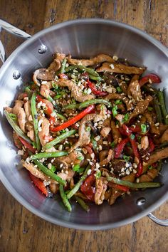 This spicy garlic pork stir fry is the perfect weeknight takeout fakeout! This stir fry is packed with pork, mushrooms, red bell pepper and green beans.
