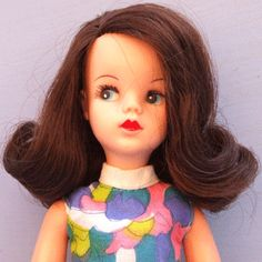 had a Sindy doll as my hair was dark and i wanted it to look like me! i wish
