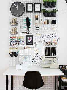 Floor-to-ceiling pegboard makes a statement in this studio of craft blogger Mandy Pellegrin from Fabric Paper Glue. A monochromatic black and white palette lets the colorful craft supplies pop.