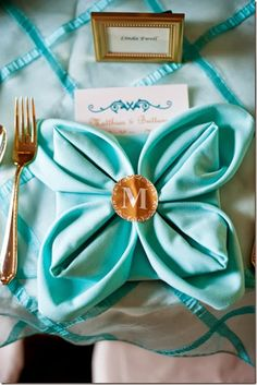 Aqua Wedding Ideas | Setting for Four: 20 Plus Napkin Folding Styles
