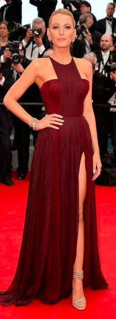 Blake Lively epitomized old school glamour in an oxblood Gucci Premiere gown and champagne accessories. #Cannes2014