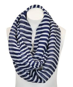 Wrap up in warmth with this chic infinity scarf. Featuring bold stripes and featherlight construction, it's sure to make an ensemble pop.