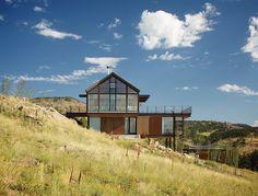 modern fire resistant green boulder loewen windows south facade triple planed low-e glass