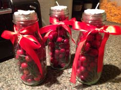 Starbuck coffee bottles made into cranberry tea light holders perfect for Christmas Cheer!