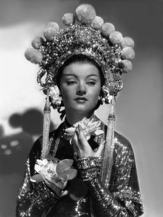 The Mask of Fu Manchu - Myrna Loy as Fah Lo See wearing an intricately beaded costume and a headpiece decorated with pearl tassels and pom-poms. The costumes were designed by Adrian. Vintage Hollywood, Hollywood Glamour, Hollywood Actresses, Classic Hollywood, Hollywood Divas, Hollywood Icons, Hollywood Fashion, Hollywood Stars, Myrna Loy