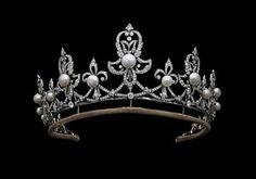 Tiara of Raine, Countess Spencer. This is the tiara of the Step-mother of Princess Diana, Countess Raine Spencer. She was the daughter of Barbara Cartland the famous romance novelist. She and her step-daughter had a tempestous relationship at best, but they eventually became friendly near the end of Diana's life.