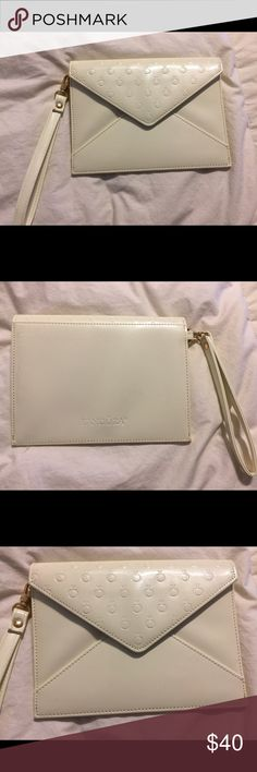 NWOT Pandora Clutch New without tags!! PANDORA WHITE CLUTCH. Great for a date night to a nice restaurant, a girls night out, or even a wedding! It still has the plastic  over the magnetic button (as seen in photo) this is such a BEAUTIFUL CLUTCH! It has several pockets for credit card, gift cards ect. It has a zipper on the inside. It's a perfect place to keep your phone or lipstick! 💄 Feel free to ask any questions! All of our prices are negotiable!! Make an offer and we will give you a…