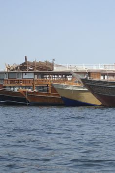 a row of parked boats in the Creek in Dubai Dubai Travel, The Row, Opera House, Boats, Building, Plant Bed, Ships, Buildings, Boat