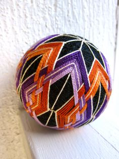 I've stitched woven diamonds on temari several times, but not like this. I like this shading and weaving idea!