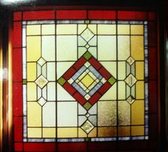 "Reds, golds , bevels, and lots of textures, with a geometric design were the requests of this homeowner.  The window is 40"" x 40""."
