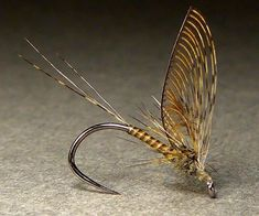 Otzinger's Single Wing Dun, a fly created and popularized by the late great Eric Otzinger. Whiting Farms CDL tails and wing, dripped peacock quill body, Whiting speckled badger rooster hackle, hare's ear thorax on a Moonlit Fly Fishing Competition Dry Fly Hook