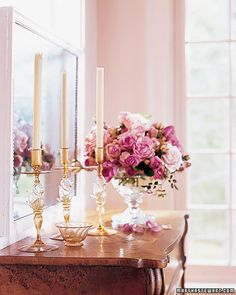 In Martha's cottage, a trio of amber-and-gold Venetian glass candlesticks makes an elegant statement atop a Victorian flip-top desk.