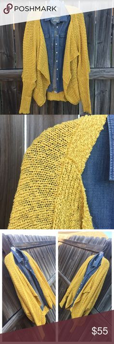 Dolman Knit Cardigan Gorgeous mustard dolman sleeve heathered knit cardigan with side pockets It does have an oversized fit. Super comfy. It has an awesome snugly comfort fit when sitting in front of the TV. Yuvicela's Closet Sweaters Cardigans