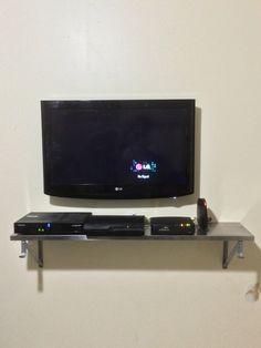 55 vizio smart tv on a tilt mount in wall hidden wires outlet 42 tv installed on a flat bracket hidden wires a wooden shelf a