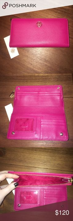 Tory Butch large snap and zip magenta wallet Authentic, new, Tory Burch large wallet in magenta. The wallet has a snap opening as well as a zipper area for change. It has an ID slot, 9 credit card holders and two other sections for storage. It is perfect for throwing in your purse or using as a mini clutch. It is in perfect condition and has never been used. Tory Burch Bags Wallets