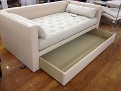 From Hickory Chair: called the Porter Divan and designed by Mariette Himes Gomezthis daybed can come with or without a back. The drawer can be storage for sweaters and other items, or a trundle with mattress, for extra guest sleeping. Custom made to order to fit any size space.