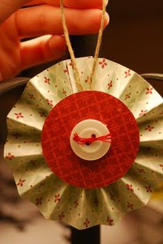 """Learn how to make a super easy Paper Lollipop Ornament! So as requested, here's a quick tutorial for my Lollipop Ornaments.  Supplies:  two 1.5""""x12"""" strips of double sided pattern paper (this will make a 3"""" diameter lollipop) two 2"""" circle"""