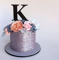 GORGEOUS, completely edible, glitter cake with gorgeous sugar flowers!