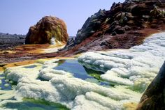 The town of Dallol was named for the volcanic explosion crater in the Danakil Depression. Part of the Erta Ale Range, the Dallol crater was formed when basaltic magma penetrated Miocene salt deposits.  The resulting hydrothermal activity created phreatic eruptions which formed the collapsed volcano. The Dallol crater is one of the lowest known volcanic vents in the world today, 150 feet (45m) below sea level.