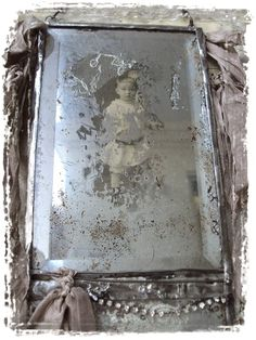 antique photo behind beveled glass ... love this image!