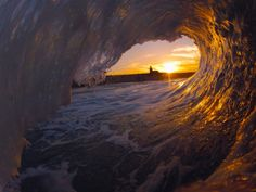 Sunrise through a wave in Santa Cruz CA