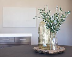 A fresh centerpiece for this dining space. We've seen a shift of indoor plant trends moving toward olive branches, or similar European style plants. We paired these branches with glossy glassware for just a touch Antique-feeling glam! European Style, European Fashion, Olive Branches, Indoor Plants, Kitchen Design, Glass Vase, Centerpieces, Touch, Trends