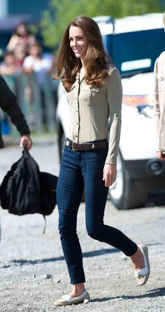 Kate Middleton wearing J Brand jeans, a military-pocket blouse by Burberry, and boat shoes by Sebago.