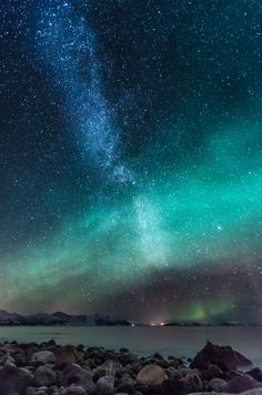 Milky way bathed in Aurora Borealis