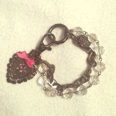 Betsey Johnson bracelet absolute perfect condition, has been sitting in my closet unworn for so many years. Betsey Johnson bracelet with hearts. little clear balls and silvery/black chain. has a pink bow... sooo adorable!! don't even think I wore this once ! Betsey Johnson Jewelry Bracelets