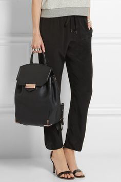 Black textured-leather (Calf) Flip lock-fastening front flap, buckle-fastening drawstring top Comes with dust bag $1050