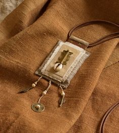 AMALTHEE CREATIONS / Long linen  pendant necklace with ethnic beads from Africa on leather cord