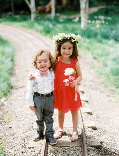The cutest flower girl and ring bearer: http://www.stylemepretty.com/2014/06/23/modern-garden-wedding-at-nestldown/ | Photography: Leo Patrone - http://leopatronephotography.blogspot.com/