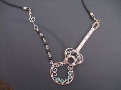 Copper, silver, turquoise, and obsidian guitar necklace that I made.  Pic only, no link