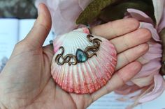 This mermaid pendant has been created completely from polymer clay and natural crystals such as labradorite and rose quartz. It features a teardrop labradorite Cabochon with a gorgeous sea blue flash.