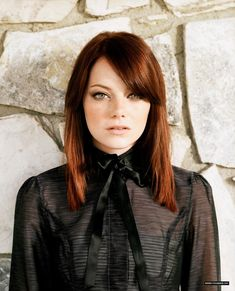 Emma Stone looks great in her natural blonde locks, but I adore this red shade she rocked for so long.