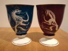 "SUSIE COOPER ""LION & UNICORN"" 1951. These three pieces are in a pattern called ""the Lion and the Unicorn"". They were used in a series of wares at the 1951 Festival of Britain."