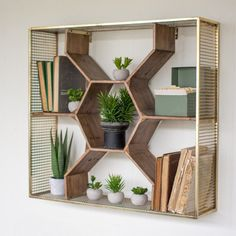 Inspired by beehives, this honeycomb shelf is surrounded by antique brass. Plants and other oddities look lovely inside the wooden octagons. Artwork and notes clip nicely to the metal mesh frame to pr