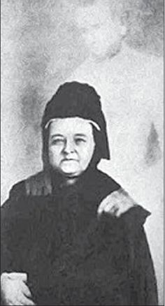 Mary Todd Lincoln with the 'ghost' of her late husband. Deeply invested in the occult for most of her life, Mary became consumed with contacting Abraham Lincoln after his untimely assassination in 1865. She was constantly holding seances in an attempt to find her husband and in 1869- or thereabouts, as the date is not entirely known- she met William H. Mumler, a well-known 'spirit photographer'.