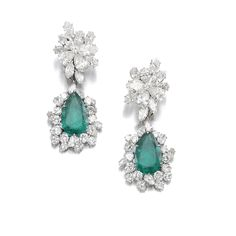 Attractive pair of emerald and diamond pendent ear clips, Bulgari, 1964 Each suspending a detachable pendant set to the centre with a pear-shaped emerald, further set with marquise-, pear-shaped and brilliant-cut diamonds, signed Bulgari, pouch stamped Bulgari.