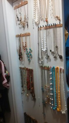 My Simple necklace storage organization solution. Cork board cut into strips, hot glued (or double sided tape) to the back of bifold closet doors. Push pins to hang necklaces from. Its flexible fast and cheap. One day I'll paint them but functionality is what is important to me :)