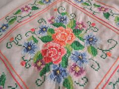 close up of lap quilt, cross stitch.