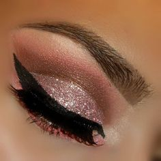 Love the copper and browns with the dramatic winged eyeliner