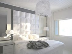 Fan DIY project using GOSA SLÅN pillows creates a classy cushioned headboard for the bedroom!